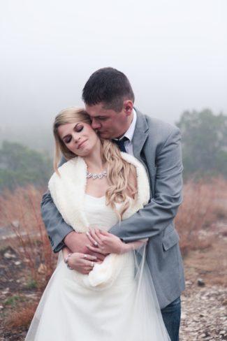 styled bride in wrap gets hug