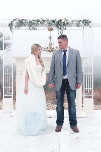 styled couple stand in faux outdoor setting