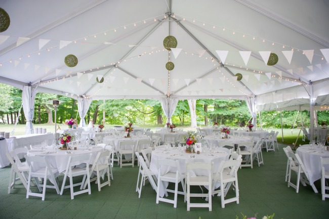tables and charis under marquee tent