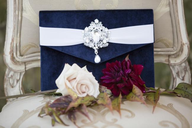 velvet blue invitation holder on chair