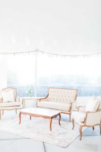 vintage furniture under white marquee