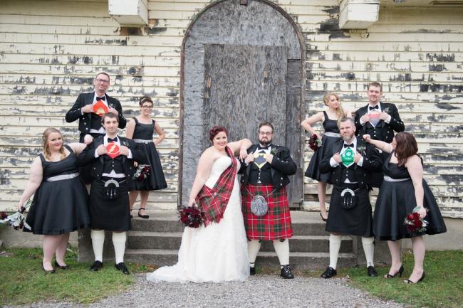 bridal party wearing superhero shirts under formal attire