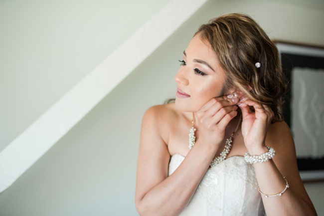 bride affixing ear ring
