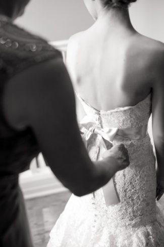 bride having sash affixed