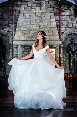 bride twirling in castle hall