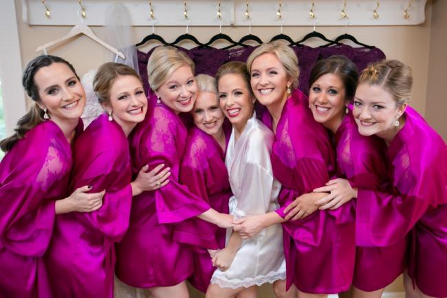 bridesmaids in bright fuschia silk robes