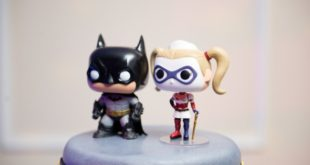 cartoon batman and wonder woman cake topper