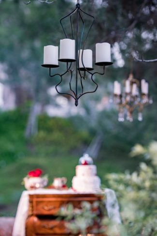 chandelier with candles hangs outdoors