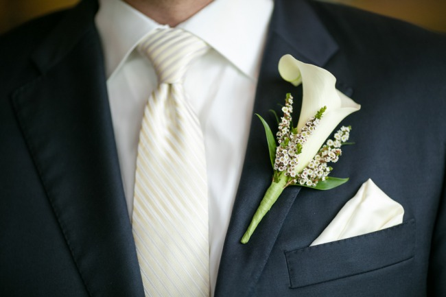 groom with boutonniere and white tie