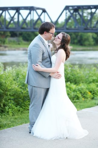 newlyweds by river in Ohio