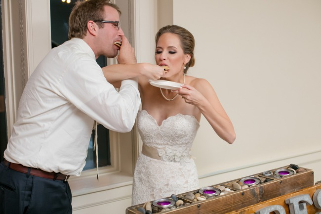 newlyweds feed s'mores to each other