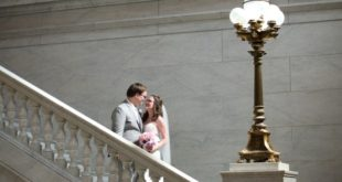 newlyweds on staircase with lamp