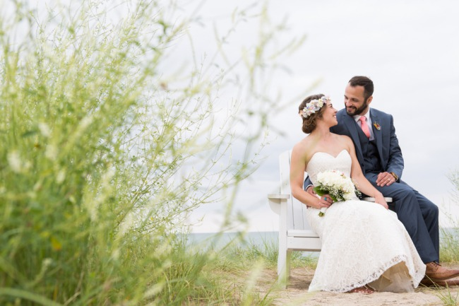 newlyweds sitting on bench
