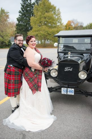 newlyweds with old Ford car