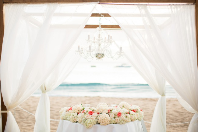 outdoor chandelier and tent on beach