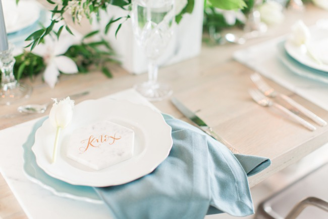 powder blue napkin and geometric marble tablescape