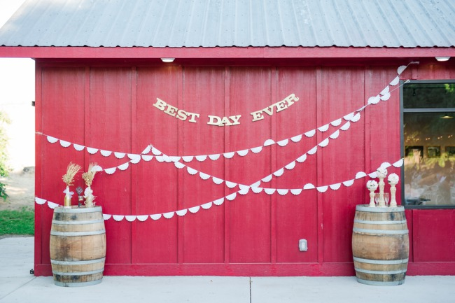 red barn with two wine barrels