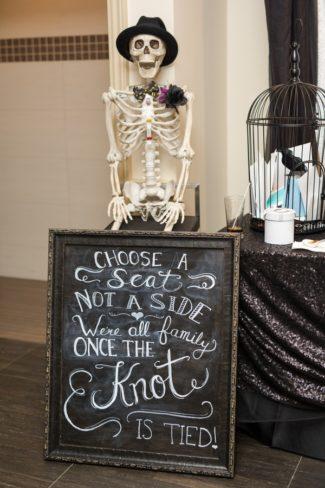 skeleton decor and chalkboard sign