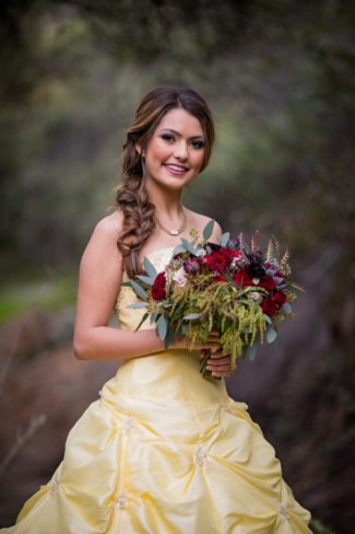 styled belle in yellow dress with bouquet