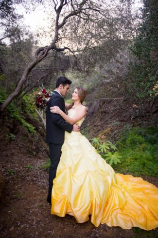 styled belle in yellow dress with her prince
