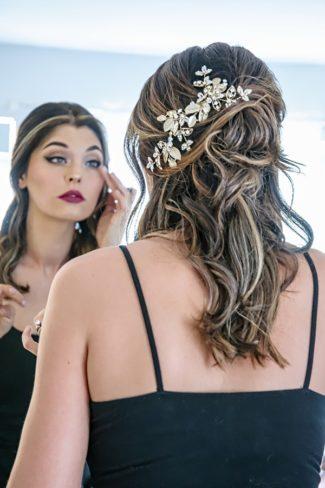 styled bride applying makeup