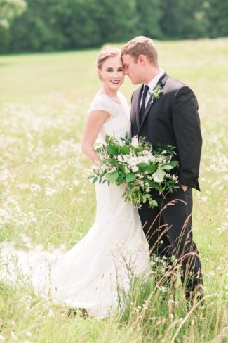 styled couple in field