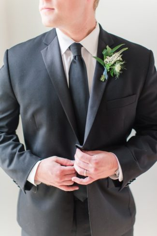 styled groom in suit