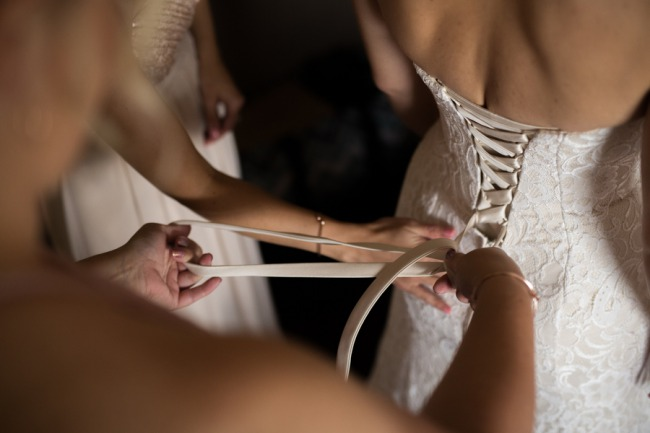 tieing up bride's dress