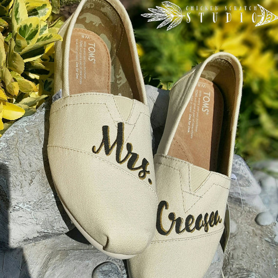However, after standing during the ceremony, and more standing at a guest receiving line that may stretch on for hours, a pair of light weight lace slip-ons may be just what your bridal tootsies need. Enter Toms shoes. You've likely heard of Toms as the shoe company that keeps on giving, literally.