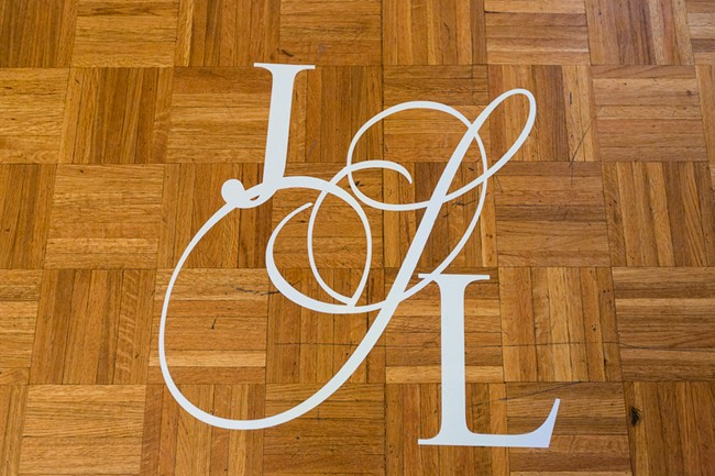 Have bride and grooms initial painted on the floor for wedding day decor