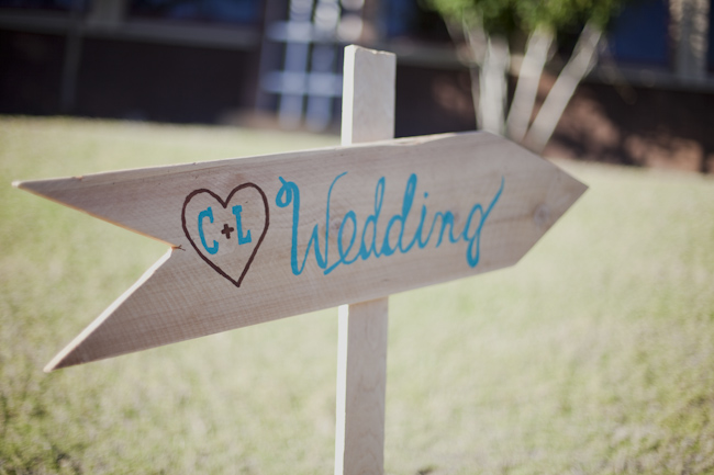 Wedding decor direction sign with bride and grooms initials