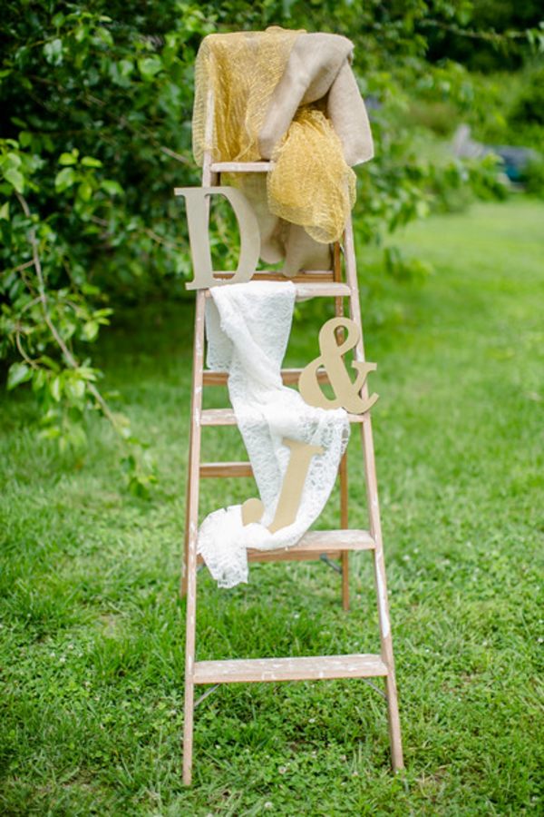 Wedding decor with ladder and bride and grooms initals