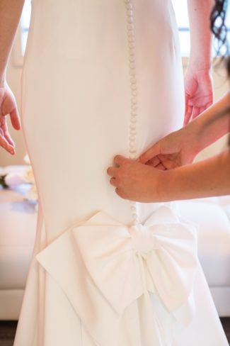 attending to bride's dress