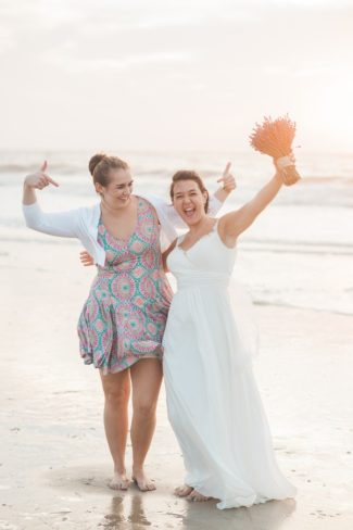 bride and bridesmaid cheer