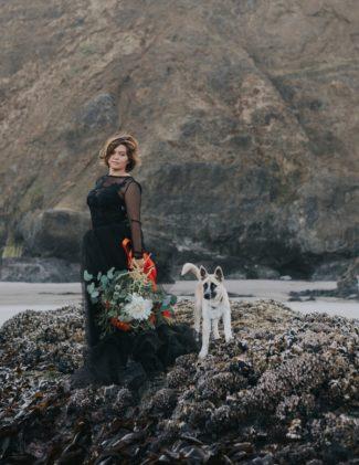 bride wearing black dress with dog