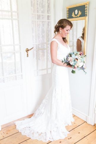 bride with bouquet in her ready room
