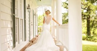 bride with parasol on porch