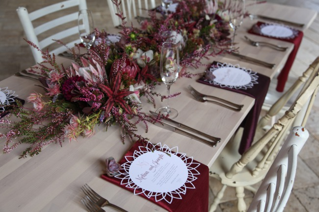 burgundy themed florals on table