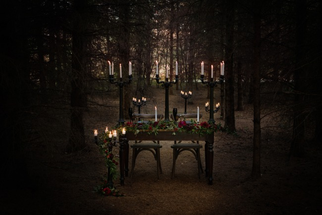 candles on table in forest