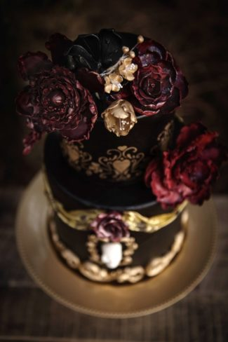 dark red and black flowers on cake