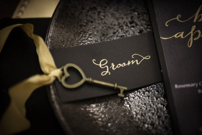 gold key and black groom label