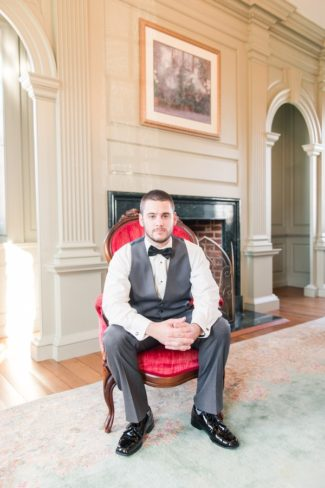 groom seated in chair
