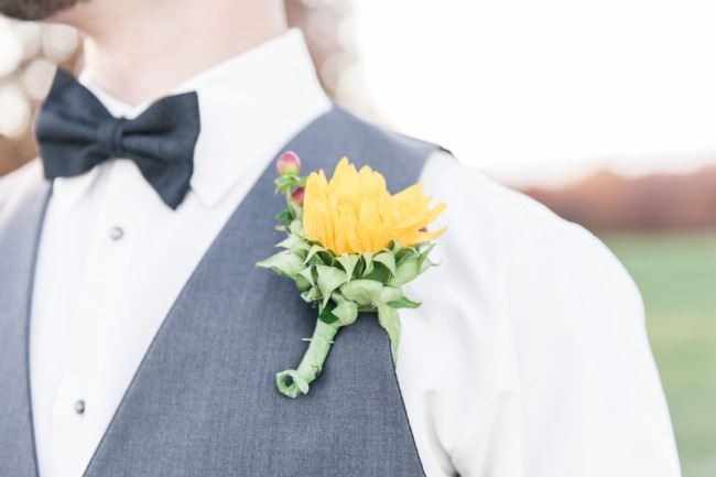 groom with sunflower boutonniere