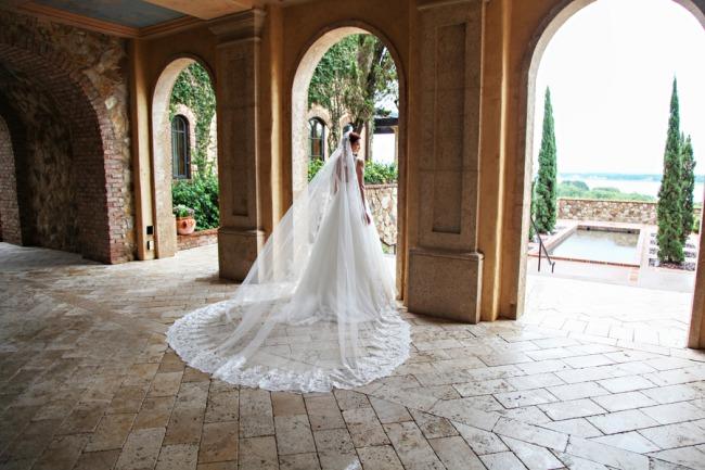 model in chapel length veil on terrace