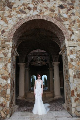 modeling dress under archway