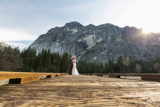 newlywed portrait against mountains