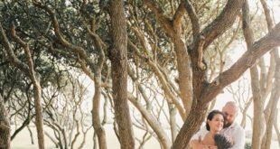 newlyweds among knarly trees