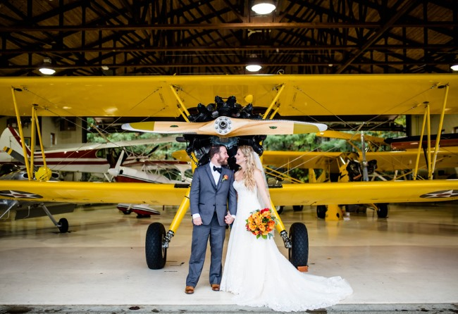 newlyweds in airplane hanger