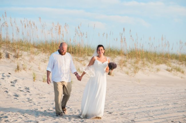 newlyweds on sandy beach