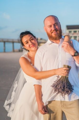 newlyweds portrait on beach